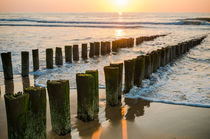 Breakwaters on the beach at sunset in Domburg Holland by 7horses