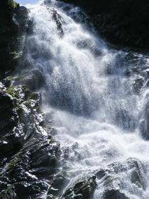Waterfall in light by Tudor Buzle