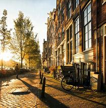 Wonderful and idyllic street scene at sunset in Amsterdam by creativemarc