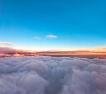 Velvet sunset above cloudscape from airplane by creativemarc