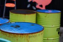 Blue and green oil barrels by Liselotte la Cour