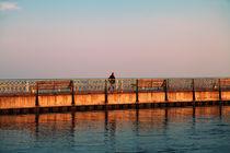 man walking along the waterfront, sunset by Ekaterina Planina