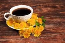 Coffee mug with flowers on wooden background  von larisa-koshkina