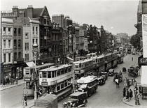 Whitechapel High Street, London, c1930  by Bridgeman Art