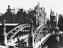 Bridge in the Speicherstadt Hamburg, c1910 by Bridgeman Art