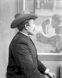 Paul Gauguin 1848-1903 in front of his canvases von Bridgeman Art