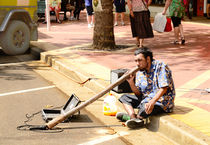 A busker playing a didgeridoo in Australia by Chris Edmunds