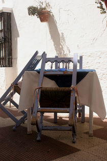 Staying hungry - table of a closed restaurant - Spain by Jörg Sobottka
