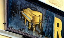 Golden piano by Leopold Brix