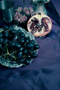 Still life with pomegranate and dark grapes by Jarek Blaminsky