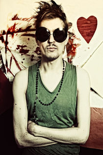 Portrait of young punk in round sunglasses by Igor Korionov