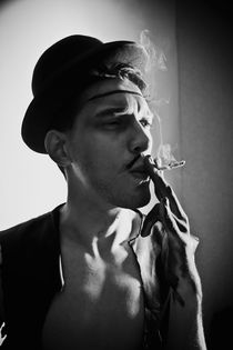 young man in a hat with a cigarette by Igor Korionov