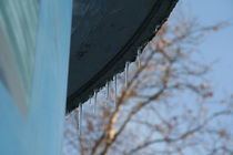 Icicles on an advertising pillar by atari-frosch