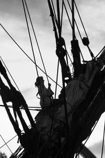 Young woman climbing in the rigging of a tall ship von Intensivelight Panorama-Edition