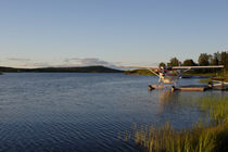 Midnight sun at lake Inari with seaplane by Intensivelight Panorama-Edition