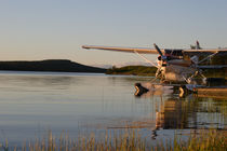 Midnight sun and plane at lake Inari by Intensivelight Panorama-Edition