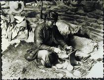 Silversmith at work, c.1914 (b/w photo)  by Bridgeman Art