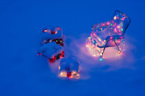 Christmas presents in snow  by Jim Corwin