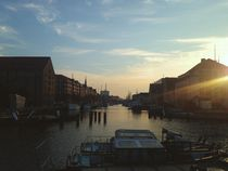 Sunset on river canal in copenhagen denmark city by Kirsty Lee