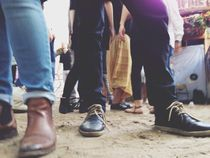 People's feet and legs in a crowd von Kirsty Lee