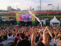 Crowd cheering at football soccer match world cup celebration by Kirsty Lee