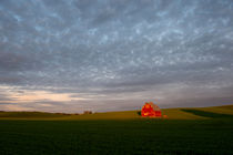 Clouds over red barn by Wolfgang Kaehler