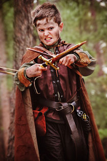Robin Hood prepares for a fight in forest by Söndra Rymer