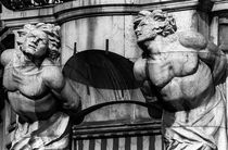 Two Male Statues above Cannes Doorway by Michael Whitaker
