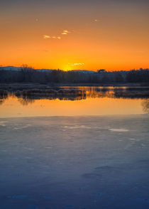 Sunset on iced lake by Giordano Aita