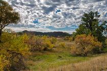 Darkening Skies Over An Autumn Landscape by John Bailey