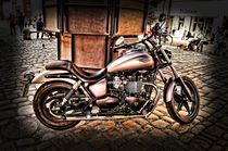 Motorcycle on the town square by Helmut Schneller