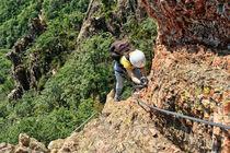 Climber on Via Ferrata by Antonio Scarpi