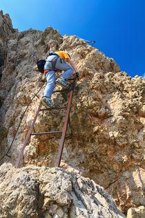 Dolomiti - hiker on via Ferrata by Antonio Scarpi