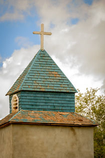 Cross and steeple on an old church by Claudia Botterweg
