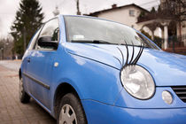 Blue funny car with eyelashes von Arletta Cwalina