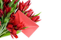 envelope in bouquet of red tulips by Arletta Cwalina