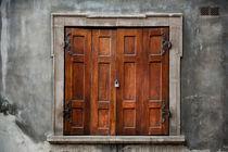Old wooden shutters close window by Arletta Cwalina