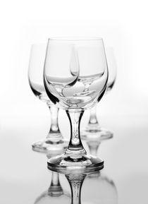 Three empty wine glasses on white by Arletta Cwalina