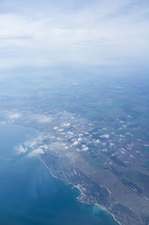 View on the seacoast through the airplane window by Igor Sinitsyn