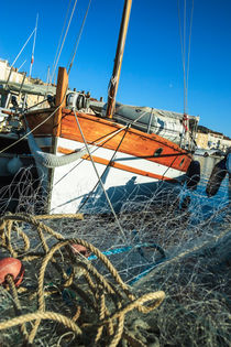 net and fisher's boat by Leandro Bistolfi
