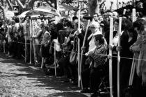 Crowd waiting by Gaspar Avila