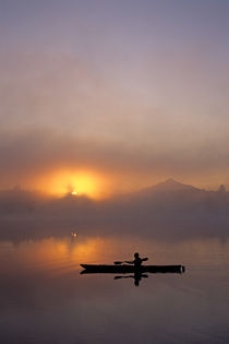 Kayaker Silhouetted by Jim Corwin