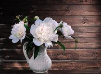 White peonies in a vase on a wooden background von larisa-koshkina