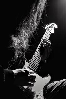 Long hair man playing guitar by Arletta Cwalina