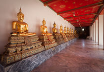 Golden Buddha Statues by Leighton Collins