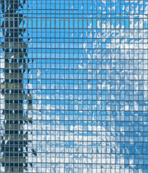 high rise building with glass facade - skyscraper by paganin