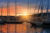harbor with sailing ships in Palma de Mallorca in sunset von paganin