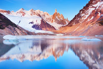 Cerro Torre, Patagonia, Argentina reflected in lake below, at sunrise by Sara Winter