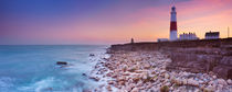 The Portland Bill Lighthouse in Dorset, England at sunset by Sara Winter