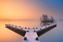 Jetty on a still lake on a foggy winter's morning by Sara Winter